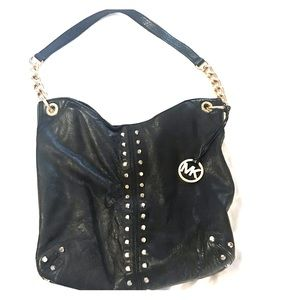 Michael Kors Black leather studded purse.